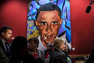 Desiree Kelly Art - Detroit based artist - Hillary Clinton at Kuzzos in Detroit Michigan. Obama cigarette painting in background (featured in The Washington post) by Desiree Kelly