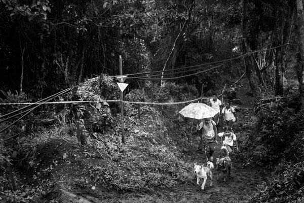 Alexis Aubin - Kids walking by a mined area on their return from school. Algeciras, Huila, ColombiaAlgeciras, Huila, Colombia - August 29th 2017