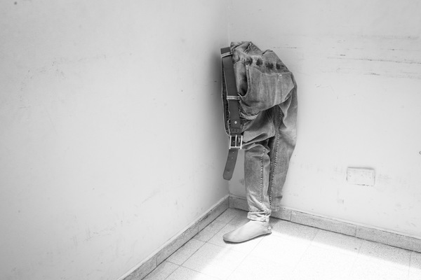 Alexis Aubin - Jean pant and a prostheses leaning on a wall of the CIREC rehabilitation center, in Bogota. Colombia has big issues to provide protheses. People can wait more than a year before getting one. Bogota Colombia - April 28th 2017