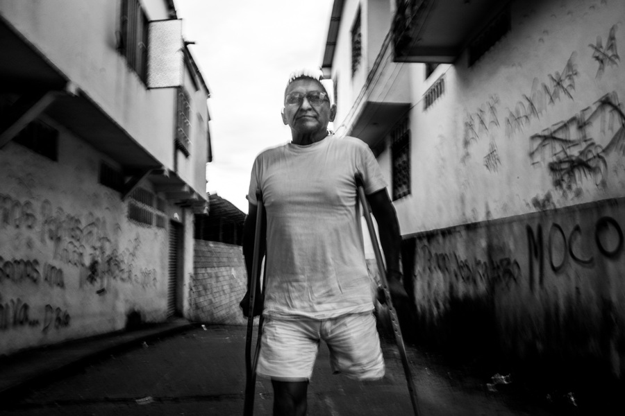 Alexis Aubin - Alonzo Ramirez Huaca stepped on a landmine in 1996 and lost his left leg. It has been the beginning of a tough road marked by self-destruction, jail and the loss of his family. He now lives in a shelter he built himself in Florencia, Caqueta, while he is working for the landmine victim's association of Caqueta. Florencia, Caqueta, Colombia - July 14th 2019