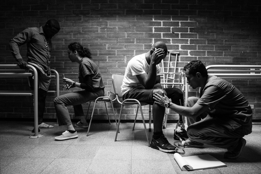 Alexis Aubin - Dirinso Arley Mosquera and Eris Valencia, landmine survivors try prosthetics at the CIREC Foundation in Bogota. Bogota, Colombia- May 22nd 2019