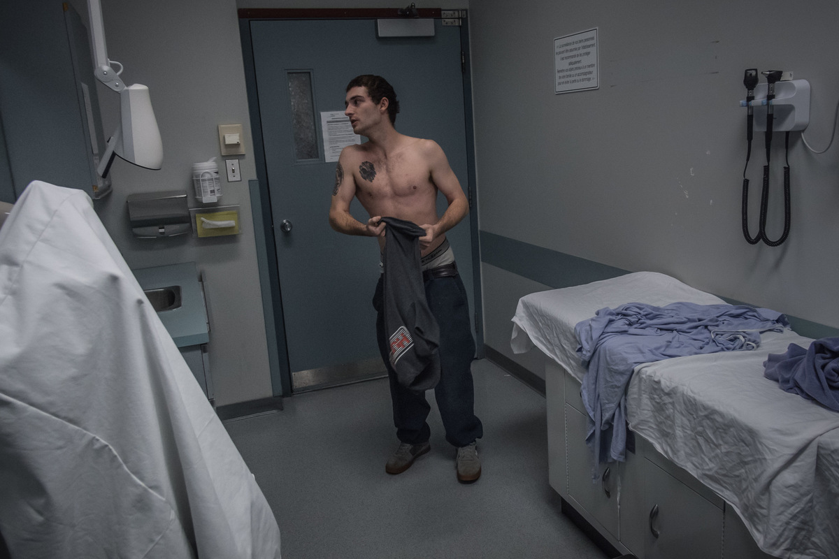 Alexis Aubin - November 2nd, 2015. Jean-Felix looks at himself in a mirror while he waits to see a doctor at the Jonquiere health center and social services . Since its release from therapy, three months earlier, he lost 20 kilograms (45 pounds).