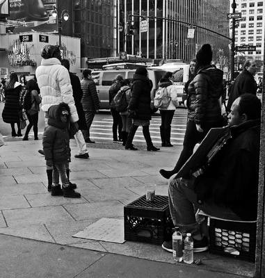 Lori George Photography - Child reading homeless mans sign asking for underwear and shoes|Macy*s 34th Street|February 2016