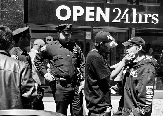 Lori George Photography - NYPD Officer overlooks person who was in some sort of confrontation|May 15,2015