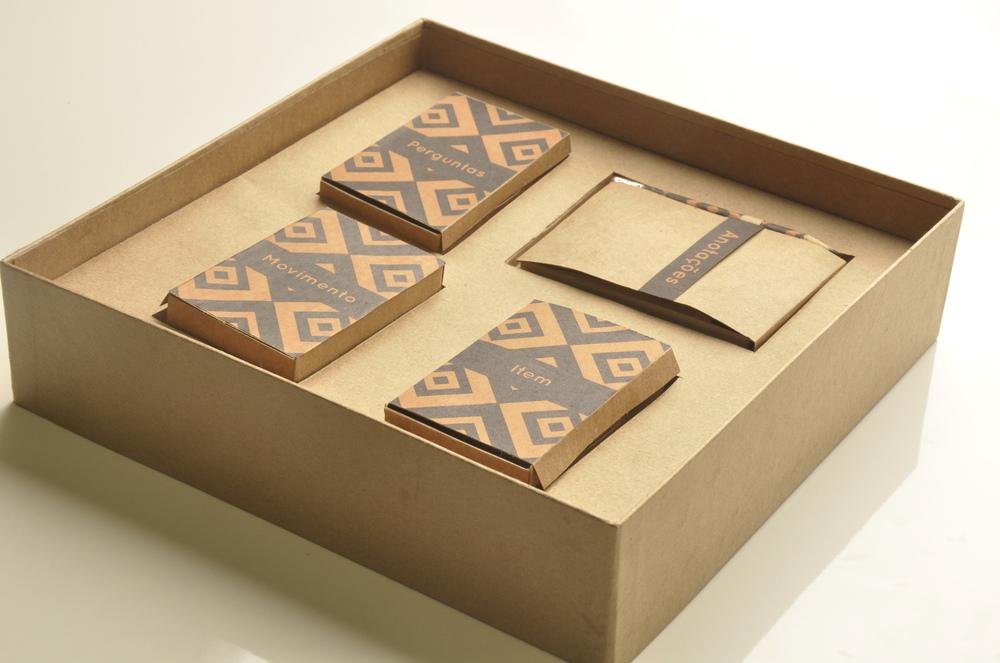 Tamys Portfolio - Board Game Iamandu: decks of cards and notebook
