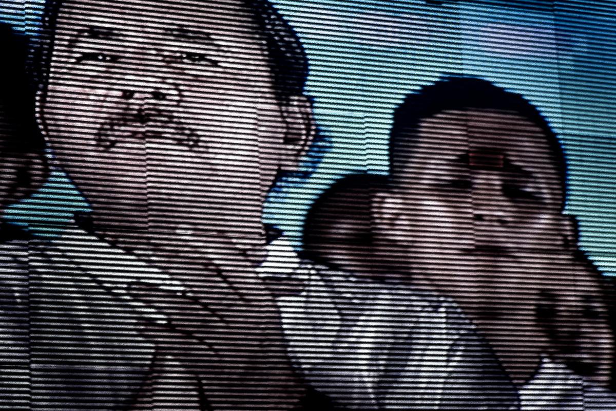 Adrienne Surprenant - Le président Daniel Ortega, lors de la fête des 35 ans de la révolution, sur un écran dans une place publique, Managua.