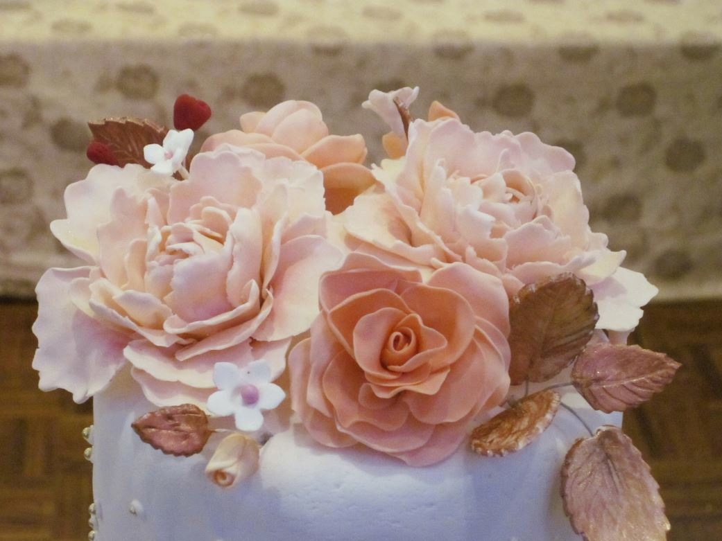 Simply Cakes - Peach flower topper for a 3 tier wedding cake!