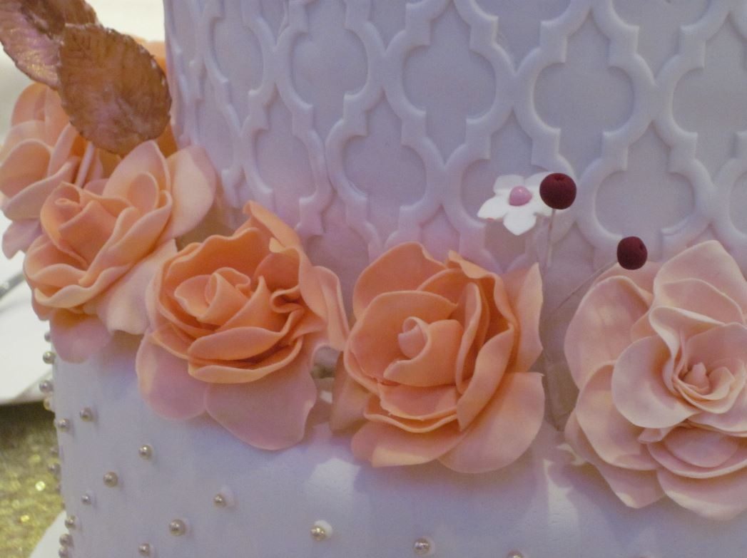 Simply Cakes - Peach flowers on a 3 tiered wedding cake!