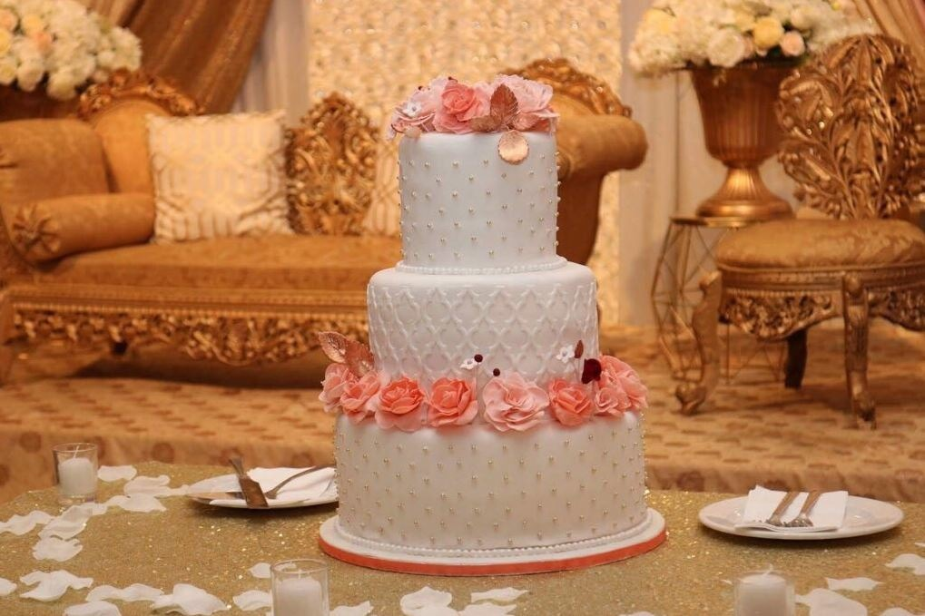 Simply Cakes - 3 Tier Moroccan style cake with peach flowers and bronze accents!
