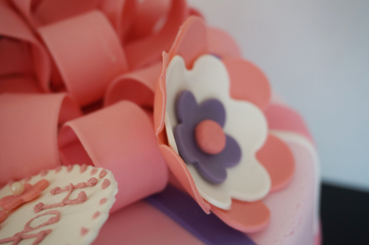 Simply Cakes - First birthday Chocolate Mud cake with pink bow topper and flower details