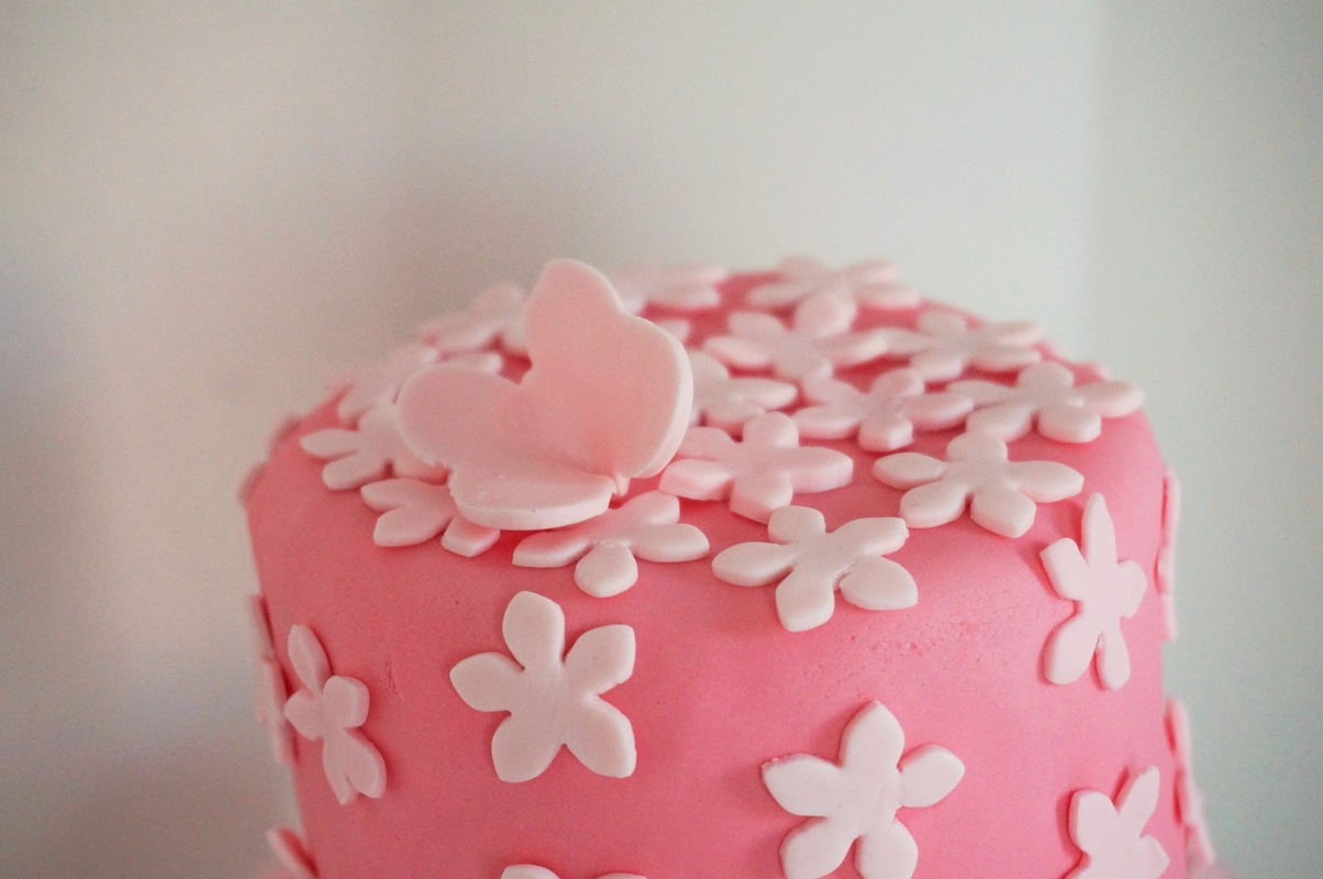 Simply Cakes - Flowers & Butterflies - First Birthday Cake. Vanilla Base with Raspberry Curd filling