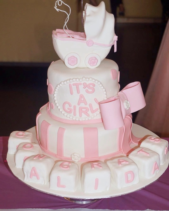 Simply Cakes - Two Tiered Baby Shower cake with Carriage Topper, Big Bow, and Block accents!