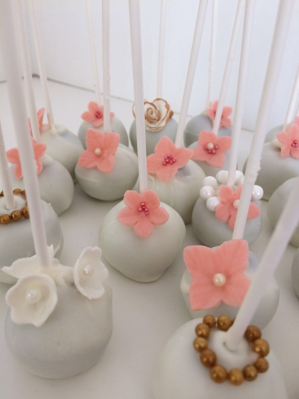 Simply Cakes - Chocolate cake pops with white chocolate, gold, and peach accents