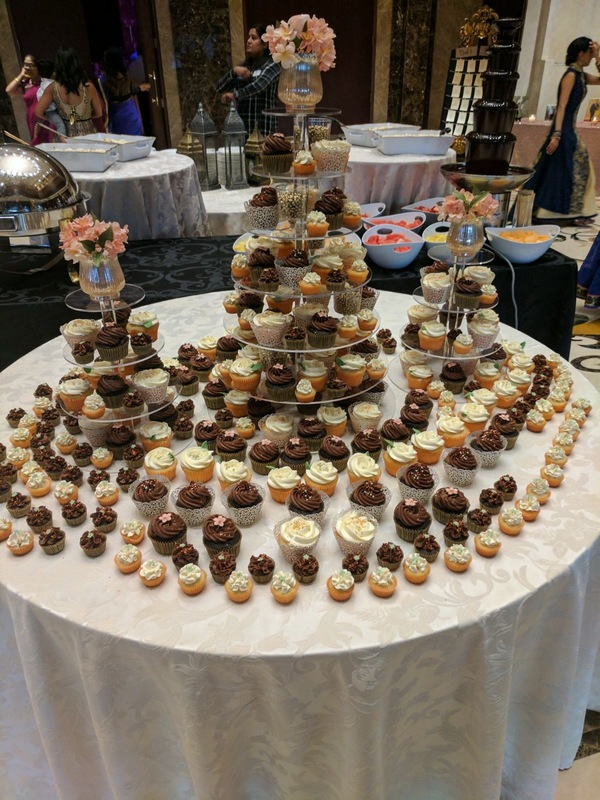 Simply Cakes - Chocolate and Vanilla cupcake tower with peach, gold, and green accents!