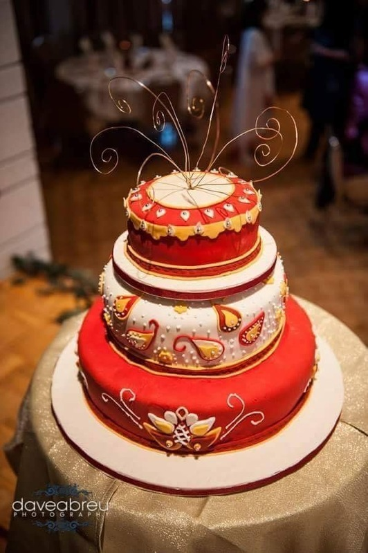 Simply Cakes - 3 tiered Indian inspired wedding cake with red, white and yellow accents