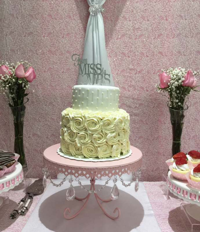 Simply Cakes - Two tiered bridal shower cake with rosettes and pearl detailing. From Ms. to Mrs. cake topper to finish off the look!