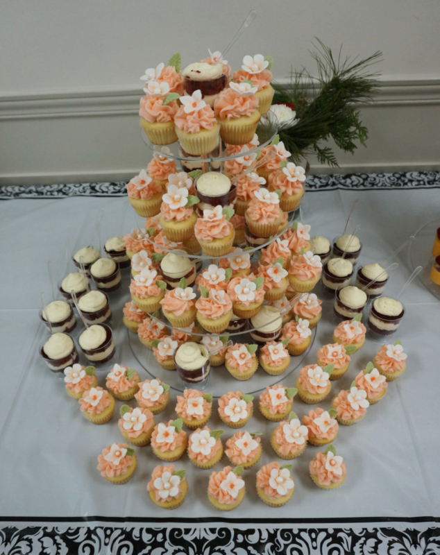 Simply Cakes - Engagement mini cupcake tower with red velvet desserts for contrast.