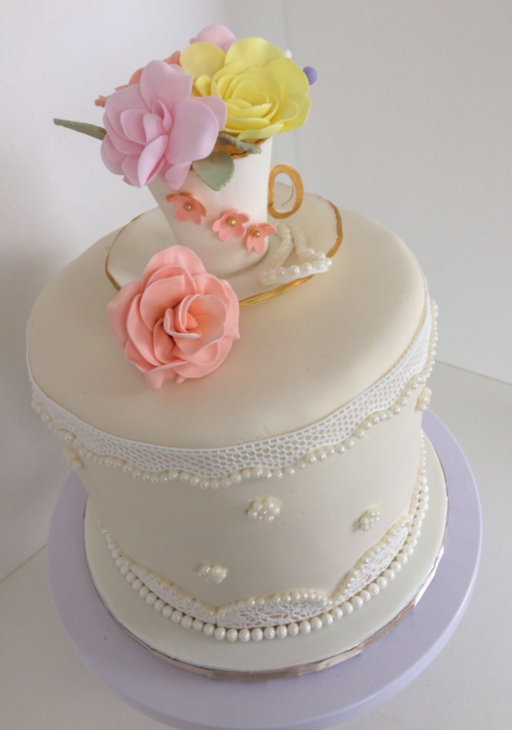 Simply Cakes - Bridal shower lace cake with tea cup and flower topper. Vanilla base with raspberry filling.