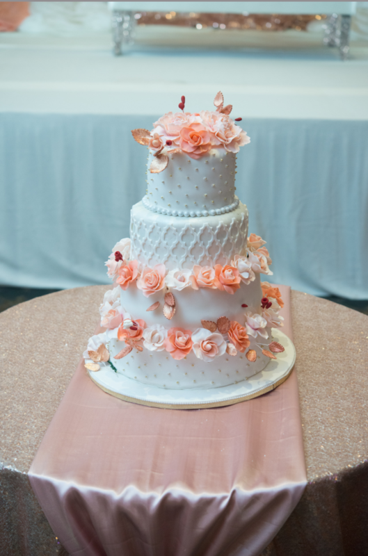 Simply Cakes - 4 Tiered wedding cake with gold dots, multi tone peach roses and peonies with Moroccan fondant pattern