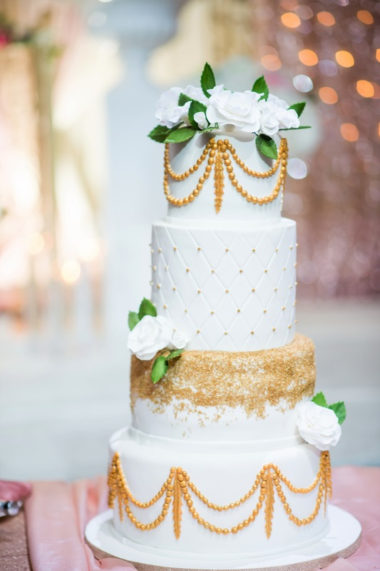 Simply Cakes - 4 tiered gold and white wedding cake with flower topper