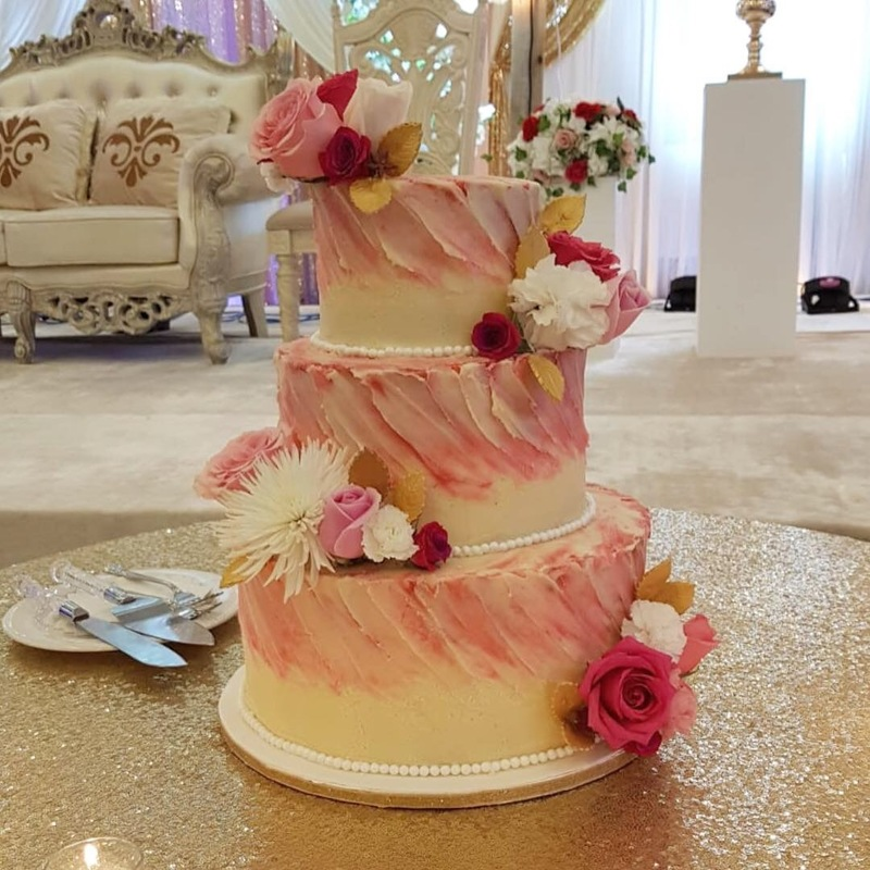 Simply Cakes - Pink and white buttercream cake with fresh flowers and gold leaf accents