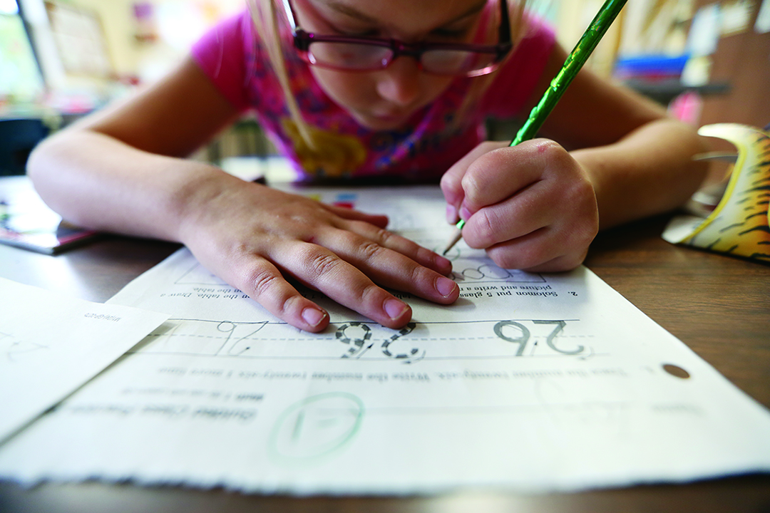 "Jennifer Gonzalez | Multimedia Photojournalist - Zoey Voudrie, 6, of Chester, corrects an error on her math homework during Mrs. Gonzalez's first grade class. ""I'll get it this time,"" Zoey said. Mrs. Gonzalez is a special education teacher and students come to her class for extra attention and assistance in schoolwork."