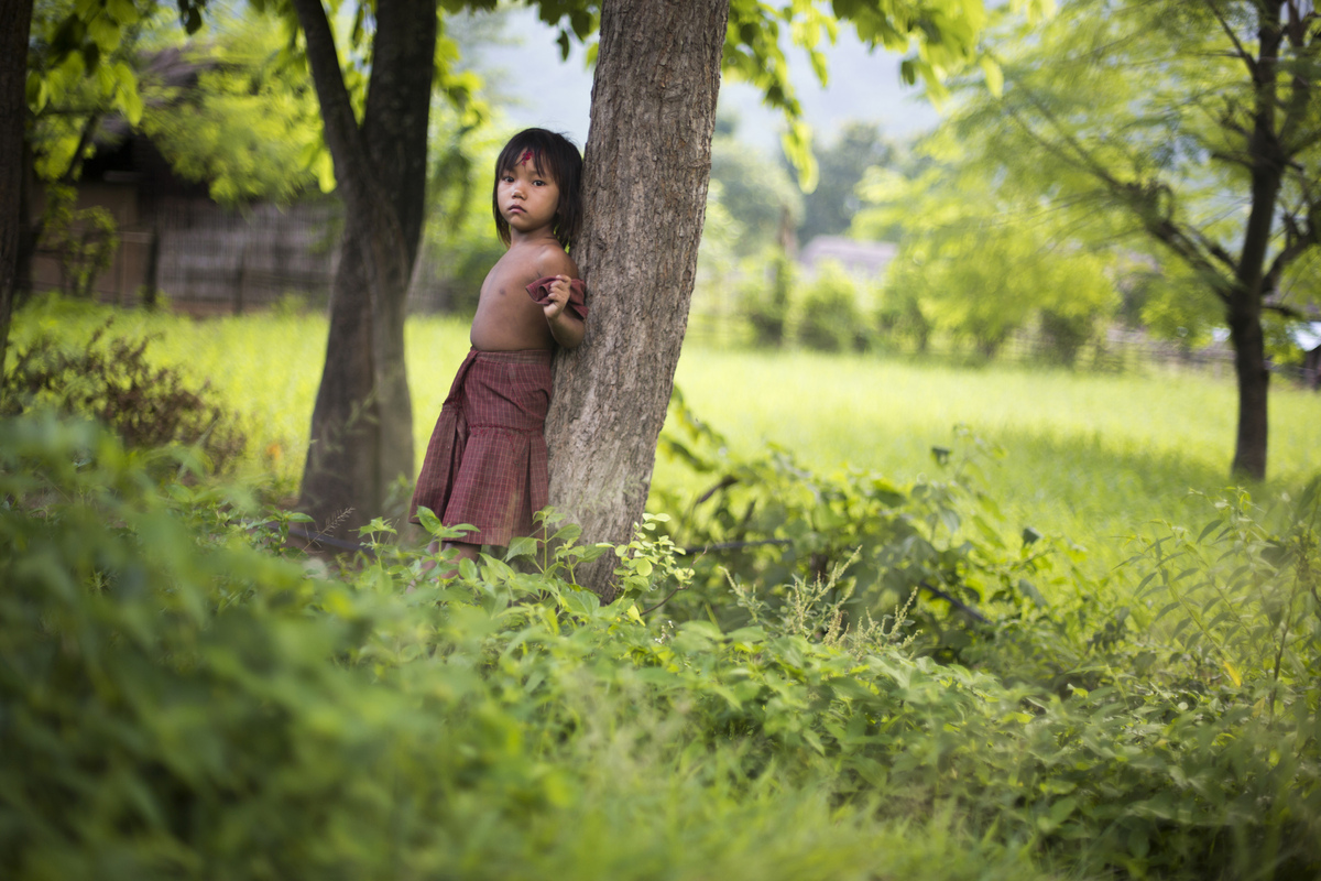 Jennifer Gonzalez | Multimedia Photojournalist - A young girl stands in a field in a remote mountainous village along the Sapta Kosi River. Nepal, 2013.