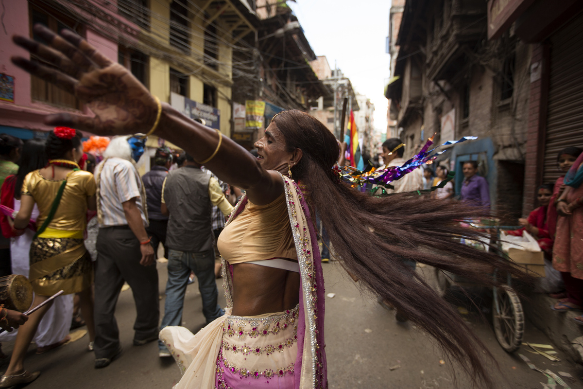 Jennifer Gonzalez | Multimedia Photojournalist - A participant dances in the streets of Thamel during a gay rights festival. Nepal, 2013.