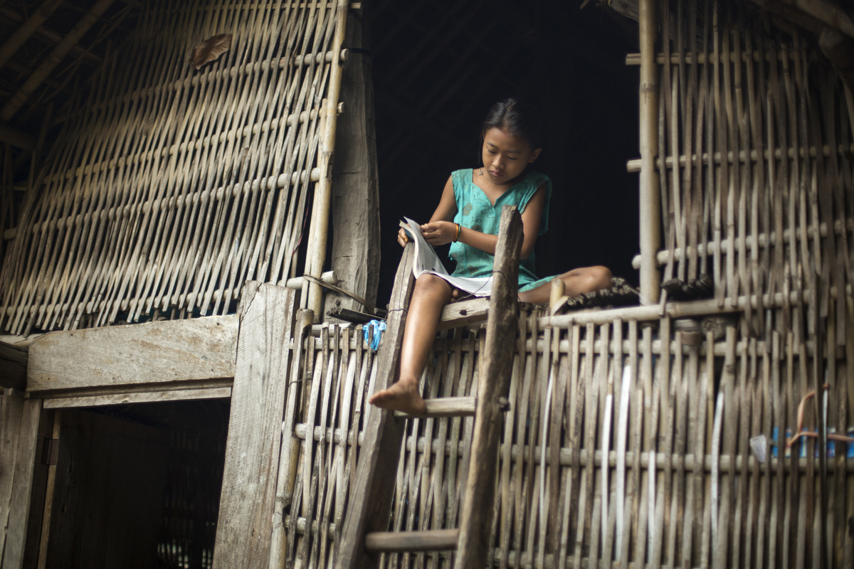 Jennifer Gonzalez | Multimedia Photojournalist - Anima Rai completes her homework before school at her home in Simli. Nepal, 2013.