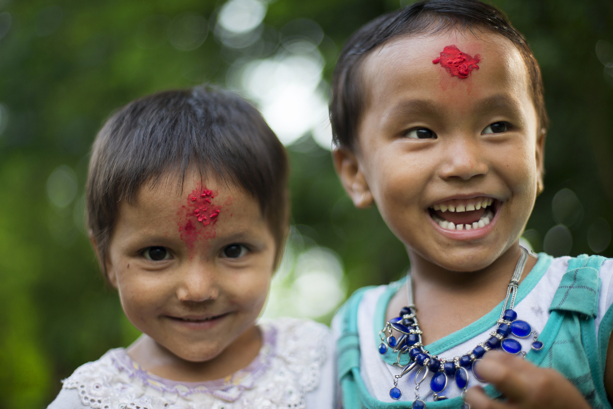 Jennifer Gonzalez | Multimedia Photojournalist - Young girls during a Teej festival in Tribeni. Consisting of about 12 houses and 50 people, Tribeni is similar to hundreds of villages that dot the hillside as you venture deep into these mountains. This is the region of the indigenous Rai. Nepal, 2013.