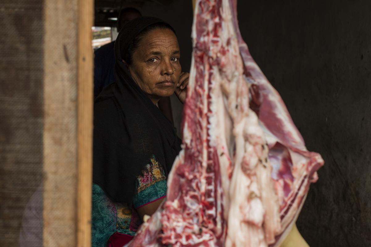 Jennifer Gonzalez | Multimedia Photojournalist - A woman sits in her familys meat shop in Biratnager. Nepal, 2013.