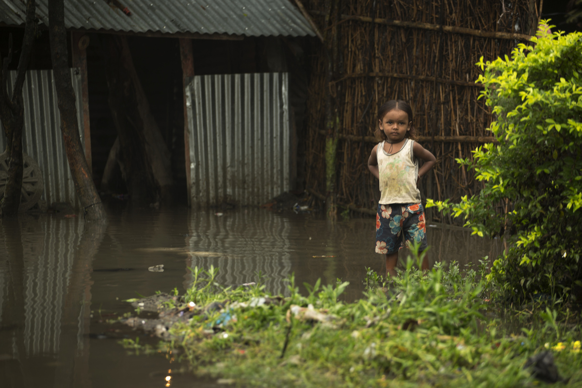 Jennifer Gonzalez | Multimedia Photojournalist - A young girl stands outside of her flooded home in Biratnagar. Nepal, 2013.