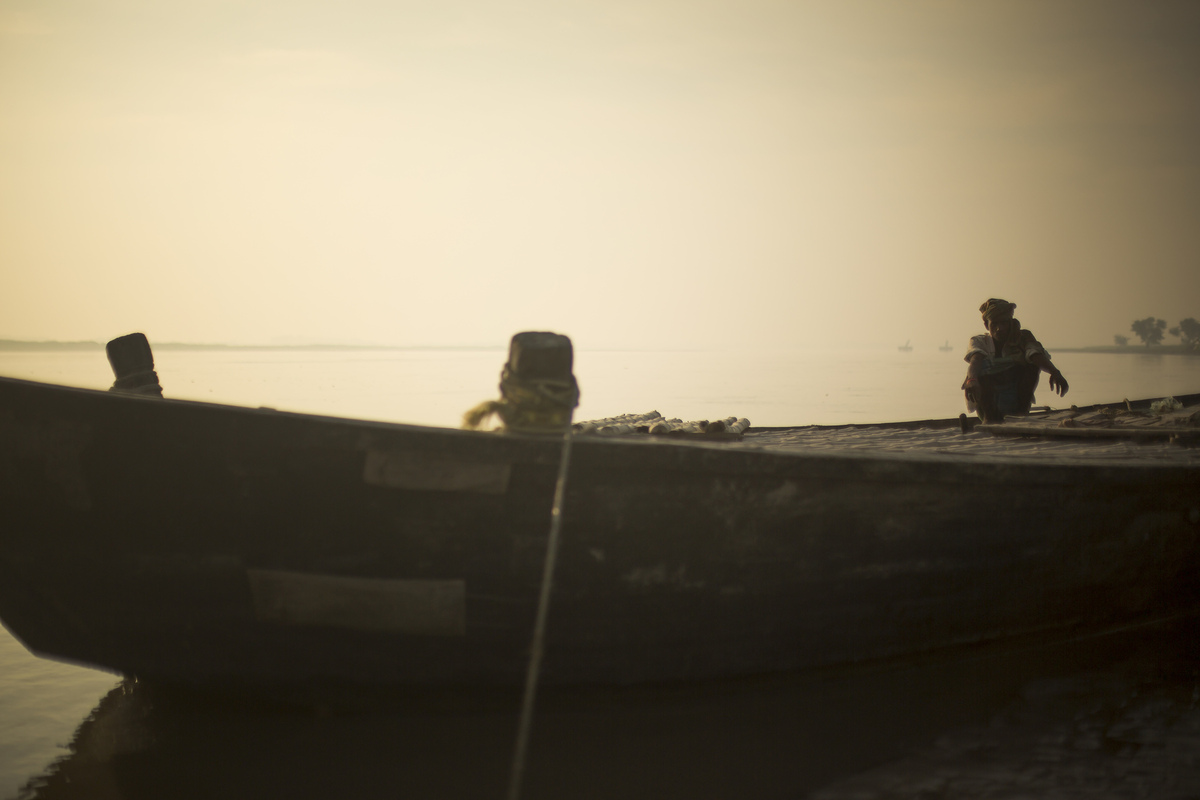Jennifer Gonzalez | Multimedia Photojournalist - A ferry boat captain waits to cross the Sapta Koshi River in the district of Saharsa, India. India, 2013.