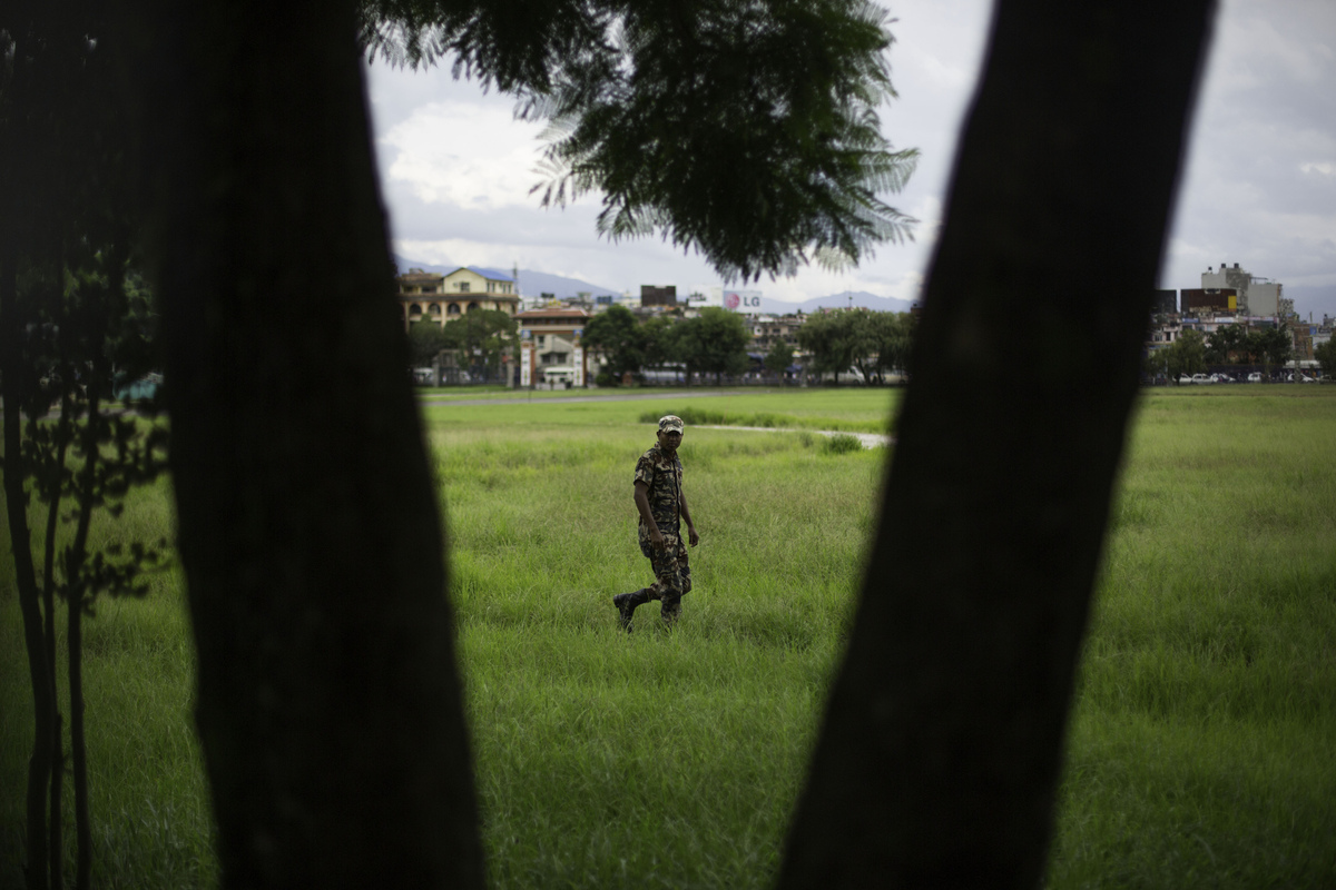 Jennifer Gonzalez | Multimedia Photojournalist - A military member walks grounds in Dubar Square. Nepal, 2013.
