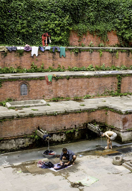 Jennifer Gonzalez | Multimedia Photojournalist - Locals wash their clothes and bodies in a dhara, a stone tap that streams ground water in Thamel. Nepal, 2013.