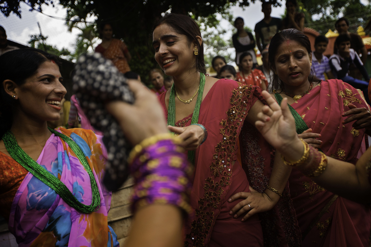 Jennifer Gonzalez | Multimedia Photojournalist - Women dance in groups during a Teej Festival, a celebration that honors the womans husbands. Nepal, 2013