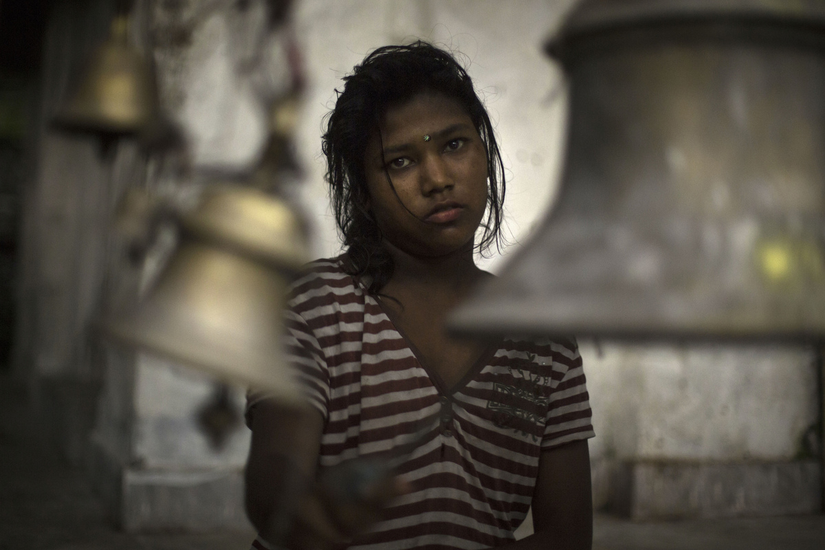 Jennifer Gonzalez | Multimedia Photojournalist - A young girl rings the bells at the Barah Chhetra Temple during worship in the village of Barah Chhetra. Nepal, 2013.