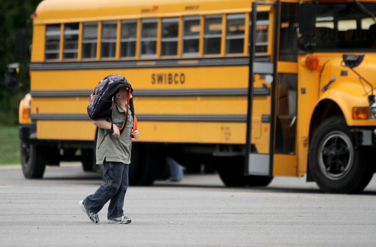 Jennifer Gonzalez | Multimedia Photojournalist - Jessie Acocks, 5, walks towards his bus at the end of an early dismissal day at Chester Grade School.